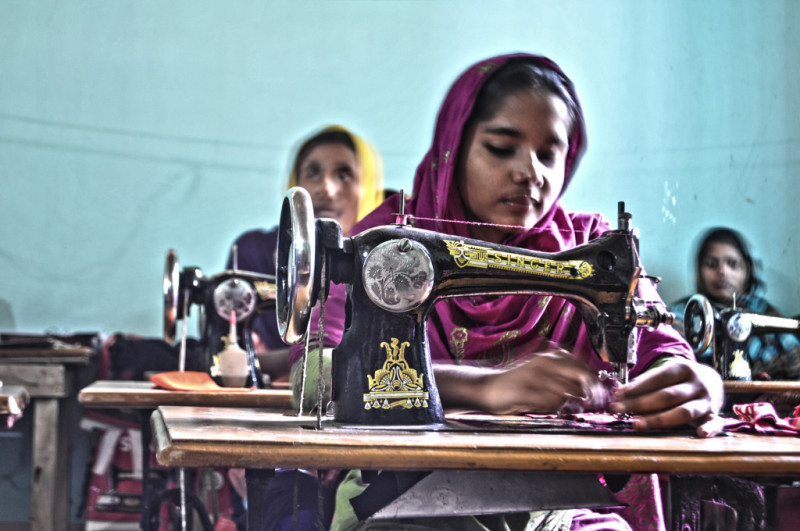 Factory worker sewing Clothes